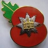 Poppy badge with the Royal Anglian Badge